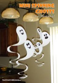 cheap halloween ideas party frugal decorating for halloween cardboard spinning ghosts free