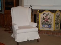 white fabric chair cover for wingback chair in living room with