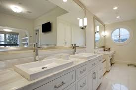 white framed mirrors white bathroom vanity with black mirror