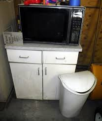 Microwave Storage Cabinet Vintage Ge Microwave Storage Cabinet And Sterilite Trashcan