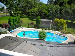 small swimming poll in the modern house backyard with beautiful