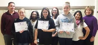 Pictured above are the organizers and winners of the Jane Addams Day      Essay Contest  In the front row  from left  are Breanna Hall  second place       Western Illinois University