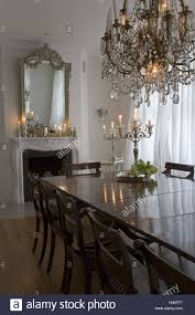flat dining room chimney mirror dining table chandelier stock