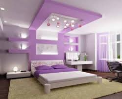 Purple Themed Bedroom - blue bed on white platform completed purple and blue bedroom black
