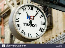tissot clock with swiss flag outside waxworks barcelona stock