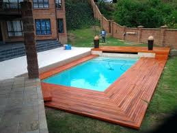 outdoor lighting for above ground pool decks with rustic wood