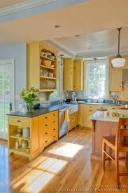 yellow kitchen wood cabinets country kitchen design pictures and decorating ideas