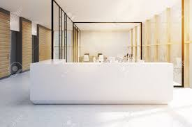 Standing Reception Desk White Reception Desk Standing In An Office With Glass Walls