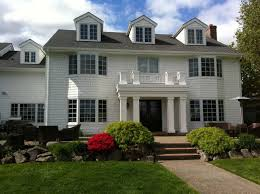 white two story colonial home with classic square pillars 50428