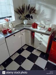 black white chequerboard vinyl flooring in small white kitchen