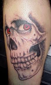 devil skeleton with red eyes tattoo photos pictures and