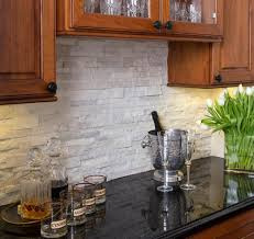 Stacked Stone Kitchen Backsplash Stacked Stone Quartz Backsplash Under Cabinet Lighting Cherry