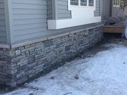 home gray stone veneer siding ranch stone white trim black