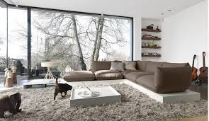 Modern Living Room Rugs Ultra Modern Living Room With Brown L Shaped Sofa Big Glass Window