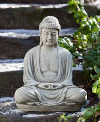 relaxing cast garden statue depicts the buddha mediating in