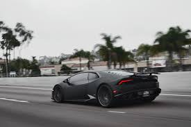 all black lamborghini matte black lamborghini huracán by gmg racing rear side view on