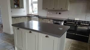 pastel shaker kitchen with concrete worktops kitchen island with