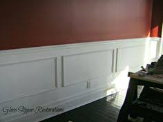 merlot red paint color over faux wainscoating