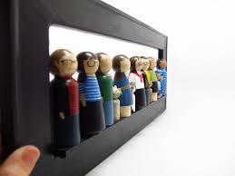 a unique family portrait custom painted family of 13 wooden peg
