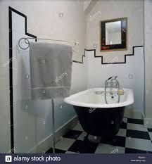 bathroom tiling bath monochromatic stock photos bathroom tiling roll top bath and black white chequerboard tiled floor in an eighties bathroom with