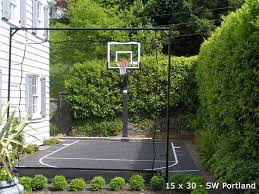 Backyard Sport Court Cost by Small Side Yard Basketball Court W Boxwood And Net Barriers