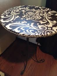 how to cover a table cover old tables with fabric and use mod podge to seal i have a