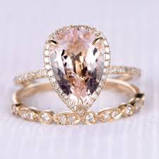 pear morganite engagement ring with diamond wedding bands halo