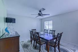 Traditional Dining Room With Limestone Tile Floors  Ceiling Fan - Dining room ceiling fans