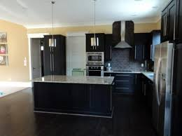 kitchens with different colored islands kitchens with two different colored cabinets white wall painting