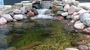 how to build a pond in your backyard using stone and river rock