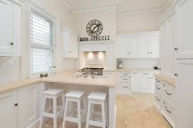 modern kitchen designs which use a white background in the entire