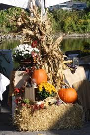 Fall decor straw pumpkins mums corn stalks