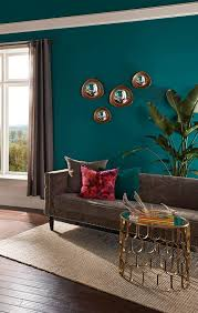 a rich teal hue of behr premium plus ultra coats the walls and