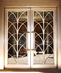 the patterns on these doors are a form of repetition because the