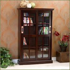 Living Room Cabinets With Glass Doors Nature Brown Living Room With Espresso Glass Door Dvd Storage