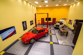 circletrac coin top garage flooring a porsche and a vw thing in a garage with a lift and circletrac garage flooring