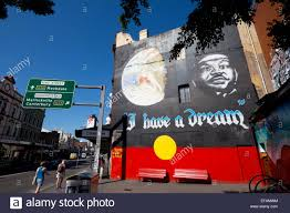 i have a dream martin luther king mural on aboriginal flag stock i have a dream martin luther king mural on aboriginal flag background on wall king street newtown inner west suburbs sydney ne