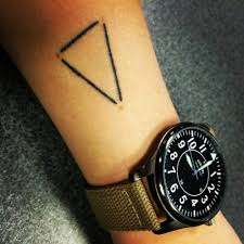forearm tattoo of a triangle on grace jacobsen a triangle
