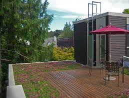 exterior design rooftop deck ideas with wood siding and umbrella