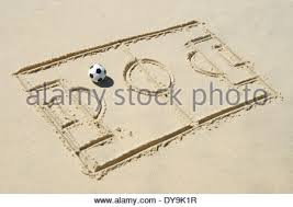 simple line drawing of football pitch with soccer ball in sand on