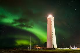 aurora borealis northern lights the aurora borealis northern lights at gardur lighthouse iceland