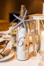 gold wine bottle table numbers a nautical blue blush and gold wedding in palm harbor florida