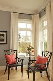 How To Put Curtains On Bay Windows Hanging Curtains On Angled Windows Hang Curtains Window And