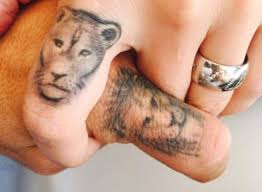 finger tattoo lioness luis suarez and wife sofia balbi show off paired lion and lioness