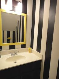 black and white bathroom decorating ideas black wooden vanity with white sink plus mirror with yellow frame