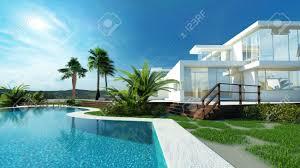 jardin paysager avec piscine maison de luxe blanc moderne avec des murs angulaires et de
