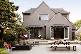 elegant exterior home color in taupe and trimmed with dark grey