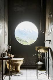 best 25 unusual bathrooms ideas on pinterest wall brackets for gold bathroom suite with a round window looking over the mountains certainly a pretty unique bathroom