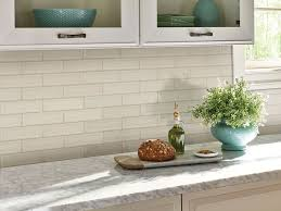 antique white kitchen cabinets with subway tile backsplash antique white beveled subway tile ceramic tile subway tile