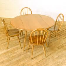 Ercol Dining Table And Chairs A 1960 S Ercol Dining Suite Mellan Rutorna Pod Logo Pinterest